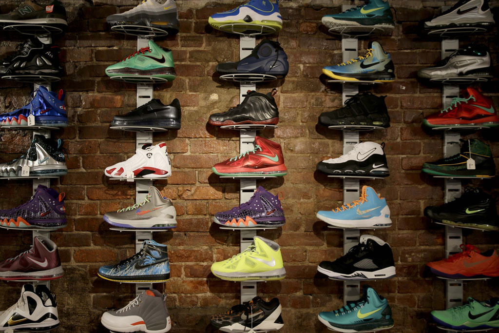 In this Jan. 12, 2015 photo, a wall of collectable sneakers are displayed at Sneaker Pawn in the Harlem section of New York. Basketball sneakers can re-sell for hundreds of dollars, depending on the model, the size of the production run and how easy it is to find a pair in good condition. (AP Photo/Seth Wenig)