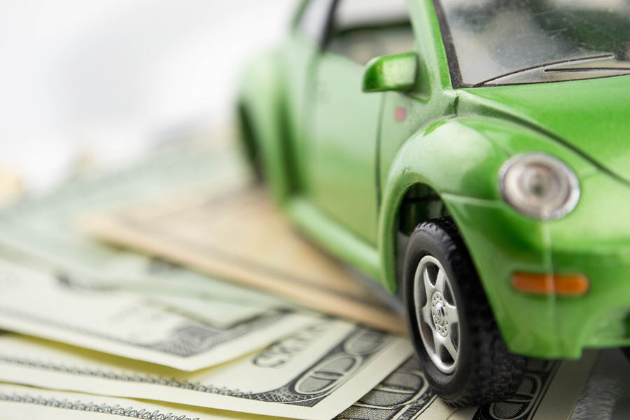 bigstock-Toy-car-and-money-over-white--49217057
