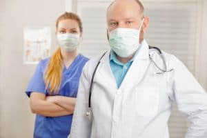Portrait Of Nurse And Doctor In Hospital